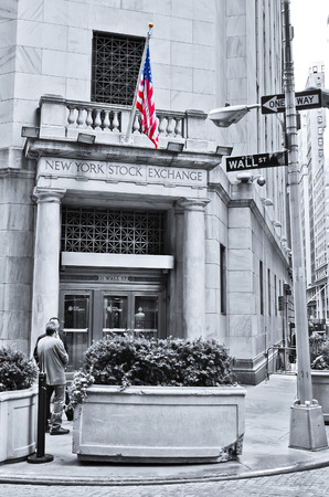 new york stock exchange: . NEW YORK CITY, NY - OCT 11: The side entrance of New York Stock Exchange and a street sign of Wall Street shown on October 11, 2013 in New York City The Exchange building was built in 1903. Editorial
