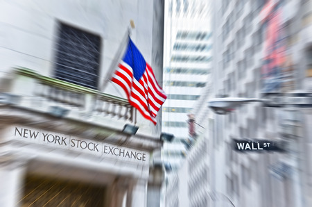 nyse: NEW YORK CITY, NY - OCT 11: A street sign of Wall Street and New York Stock Exchange is shown on October 11, 2013 in New York City The Exchange building was built in 1903..