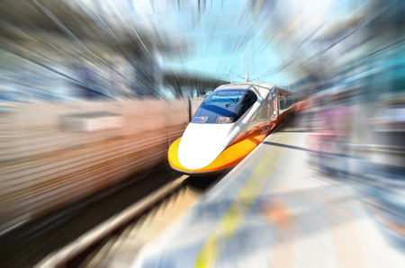 High speed train approaching railway station