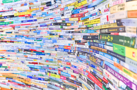 magazine stack: Layers of Chinese books stacked as a wall in the city library