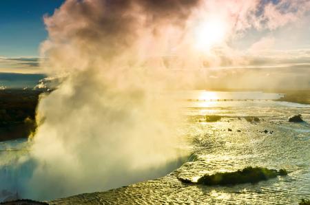the edge of horseshoe falls: View of Niagara Falls at sunrise