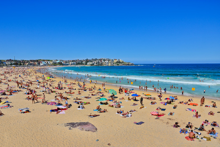 sydney: Swimmers relaxing on the beach in summer at Bondi Beach