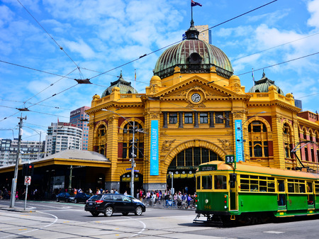 View of iconic Flinders Street Station and a vintage tram in Melbourne