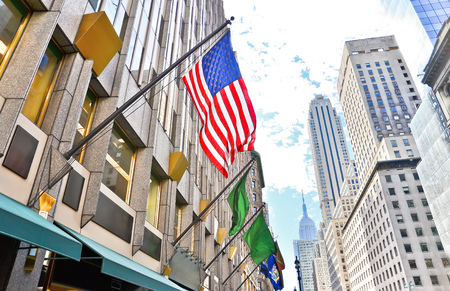 fifth: Fifth Avenue and American flag in New York City Stock Photo