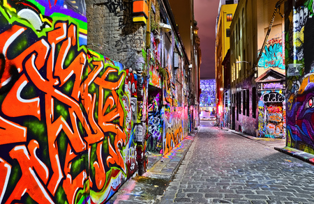 street art: Night view of colorful graffiti artwork at Hosier Lane in Melbourne