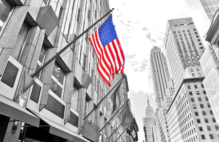 fifth avenue: View of Fifth Avenue and American flag in New York City Stock Photo