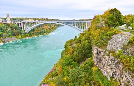 rainbow bridge: View of Rainbow Bridge in Niagara Falls in autumn Stock Photo
