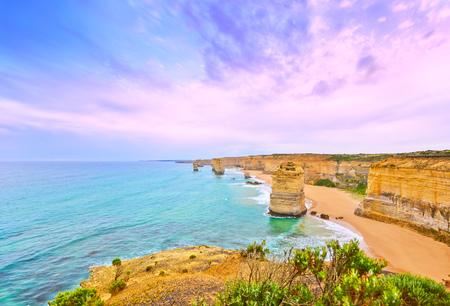 australia beach: View of Twelve Apostles by Great Ocean Road at dusk