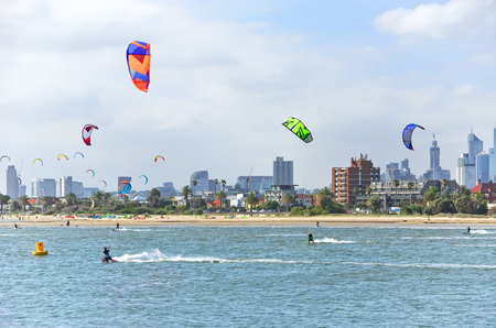 st kilda: Melbourne, Australia - January 18, 2015: People kite surfing on St Kilda Beach in Melbourne on January 18, 2015. Editorial
