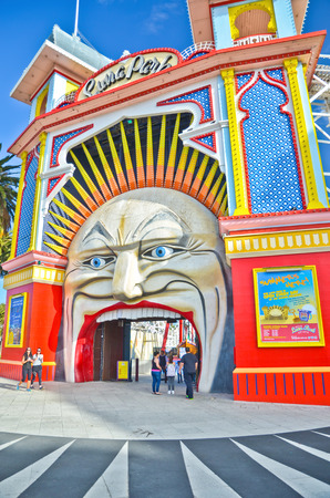 st kilda: Melbourne, Australia - January 18, 2015: People visiting Luna Park amusement park at St Kilda Beach in Melbourne on January 18, 2015.