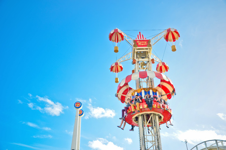 victoria park: Melbourne, Australia - January 18, 2015: People playing at Luna Park amusement park where is located at St Kilda Beach in Melbourne on January 18, 2015. Editorial