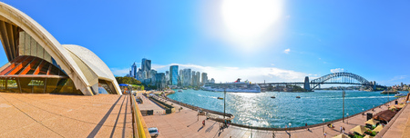 opera house: Panorama of Sydney Harbor with Sydney Opera House and Harbor Bridge in a sunny day