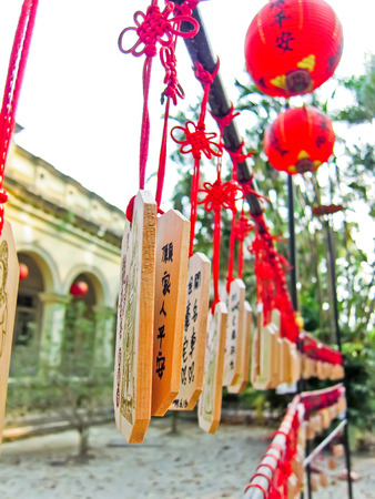 charms: Chinese wishing charms and red lanterns decorated in a park