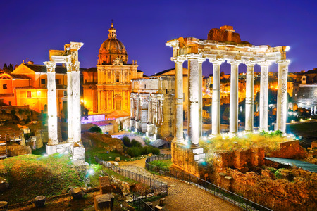severus: View of the roman ruins at night in Rome, Italy.