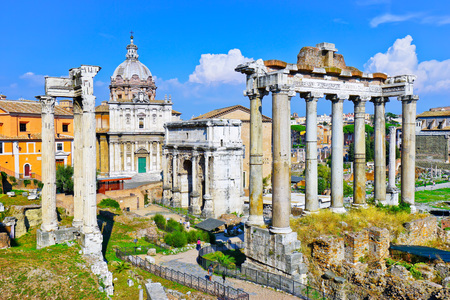 relic: View of the roman ruins in a sunny day in Rome, Italy.