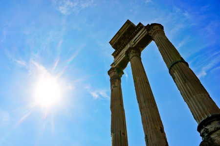 View of the columns of roman ruins in a sunny day in Rome, Italy.