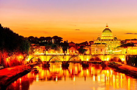 View of St. Peters Basilica and Aelian Bridge at dusk in Rome