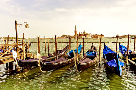 black moor: Gondolas moored by St Marks Square in Venice
