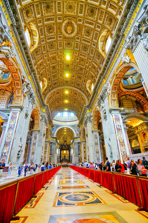 Vatican City, Vatican - September 15, 2016: Interior view of the St. Peters Basilica with lots of tourists and believers visiting in Vatican on September 15, 2016. Editorial