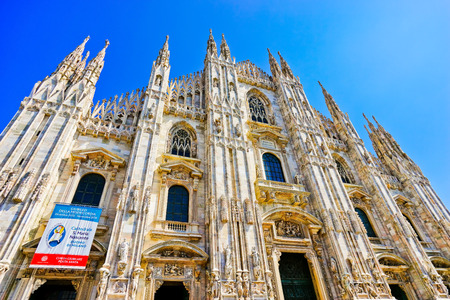 Milan, Italy - September 7, 2016: View of the Milan Cathedral in a sunny day in Milan on September 7, 2016. Milan Cathedral is the largest church in Italy and the fifth largest in the world.