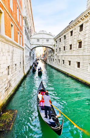 Venice, Italy - September 3, 2016: View of the Bridge of Sighs with Gondolas punted by gondoliers on the canal in Venice on September 3, 2016.