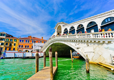 Venice, Italy - September 3, 2016: View of the Rialto Bridge and Grand Canal in a sunny day in Venice on September 3, 2016.