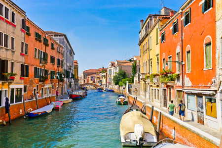 View of the colorful Venetian houses along the canal in Venice Stock Photo