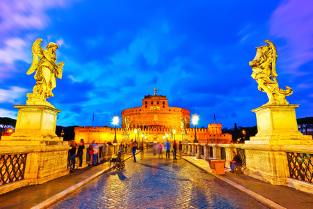 View of the Castel Sant'Angelo on the Aelian Bridge in Rome at dusk. Stock Photo - 73872067