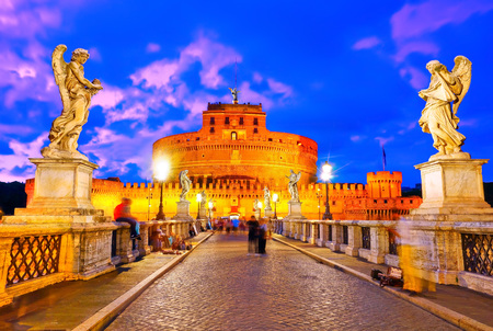 castel: View of the Castel SantAngelo on the Aelian Bridge in Rome at dusk. Stock Photo