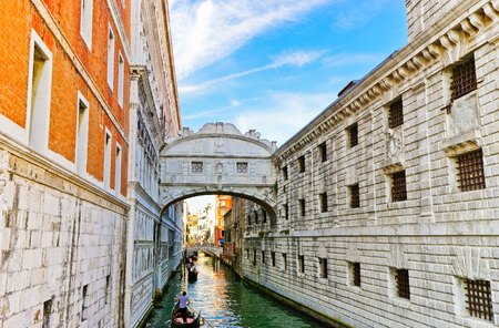 View of the Bridge of Sighs with Gondolas punted by gondoliers on the canal in Venice Editorial