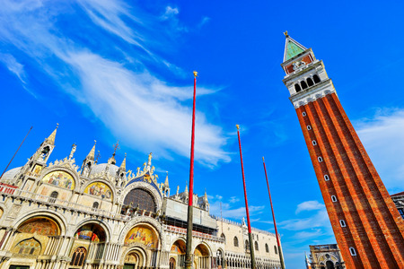 View of Saint Marks Basilica and St Marks Campanile on the St Marks Square in a sunny day in Venice. Stock Photo