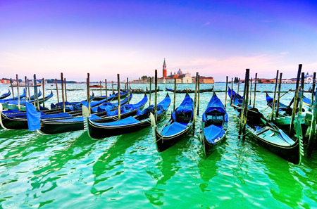 black moor: Gondolas moored by St Marks Square at dusk in Venice Stock Photo