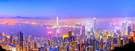 Victoria Harbor and Hong Kong skyline at dusk.