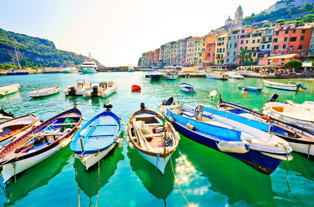Portovenere, Italy - September 9, 2016: View of the port with lots of boats mooring on a sunny day in Portovenere on September 9, 2016. Editorial