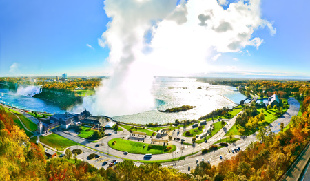 View of Niagara Falls from Canadian side on a sunny day in autumn.