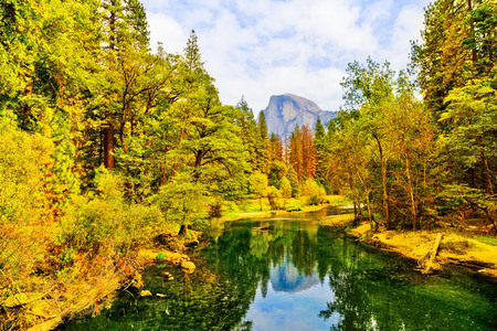View of Half Dome and Merced River from Yosemite Valley in Yosemite National Park in autumn.