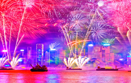 Firework display on the New Years Eve at the Victoria Harbor in Hong Kong. Stock Photo