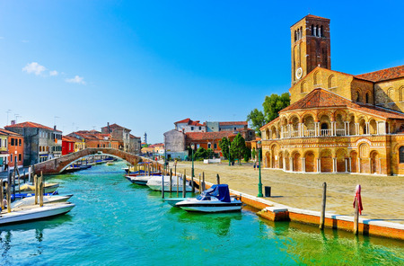 View of the colorful Venetian houses along the canal at the Islands of Murano in Venice.