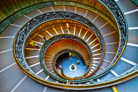 View of the spiral stairs of Vatican Museums in Vatican on September 15, 2016. The spiral stairs were designed by Giuseppe Momo in 1932. Stock Photo - 97815381