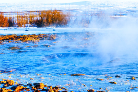 Eruption of Strokkur Geyser in winter, where is on the popular route of Golden Circle in southwest Iceland.