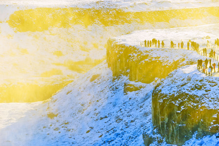 Viewpoint of Gullfoss waterfall at sunset in winter, where is on the popular route of Golden Circle in southwest Iceland.