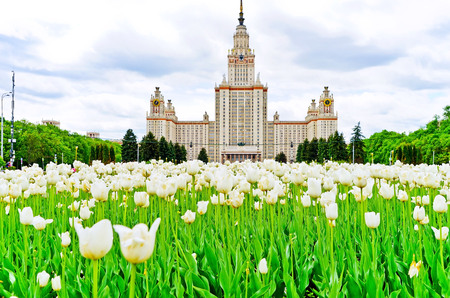 View of Moscow State University with lots of flowers in summer in Moscow.
