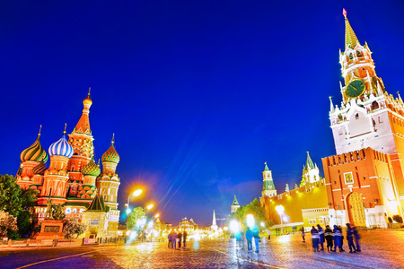 View of the Kremlin and St. Basil's cathedral on Red Square in Moscow at night.