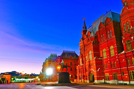 View of the State Historical Museum and War of 1812 Museum on Manezhnaya Square in Moscow at dawn.
