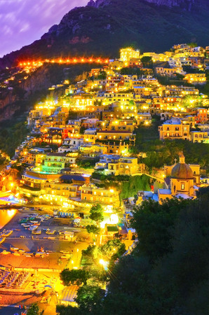 View of Positano along Amalfi Coast in Italy at night.