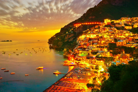 View of Positano along Amalfi Coast in Italy at sunset.