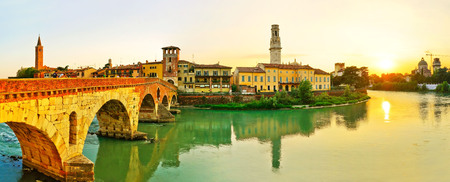 View of the Roman Ponte Pietra across Adige river at sunset in Verona, Italy. Banque d'images