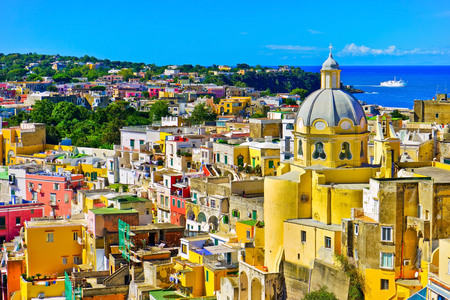 View of the colorful houses at the Port of Corricella in Procida Island, Italy.