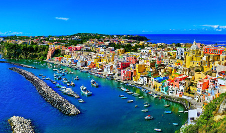 View of the Port of Corricella with lots of colorful houses on a sunny day in Procida Island, Italy. Stock fotó