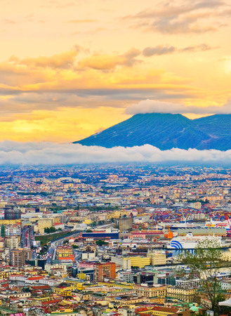 View of the city center of Naples and Mount Vesuvius along the Gulf of Naples at sunset in Naples, Italy. Editorial